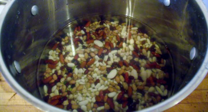 Beans in a pot with water for rinsing.
