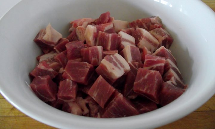 Cubed pork butt in a bowl.
