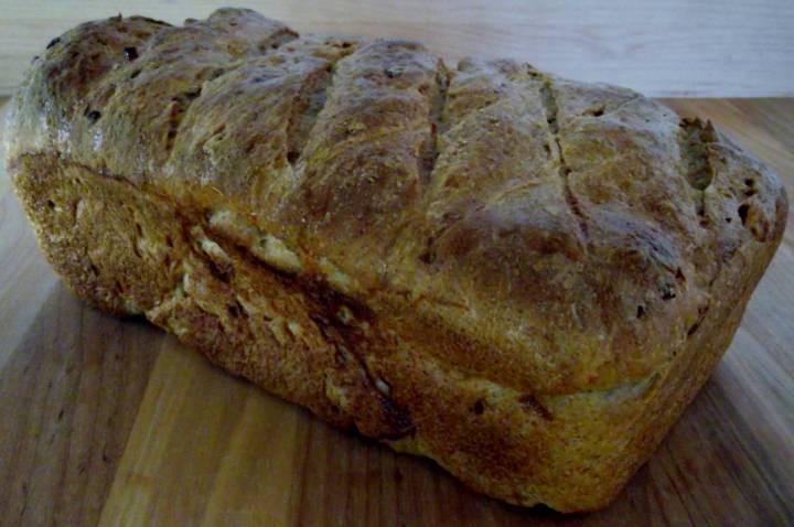 Loaf of rye bread on a cutting board.