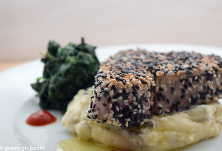 Sesame crusted ahi with wasabi mashed potatoes and sautéed spinach.