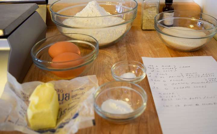 Ingredients for sesame cookies: flour, butter, sugar, salt, baking powder, eggs,sesame seeds, and anise oil.