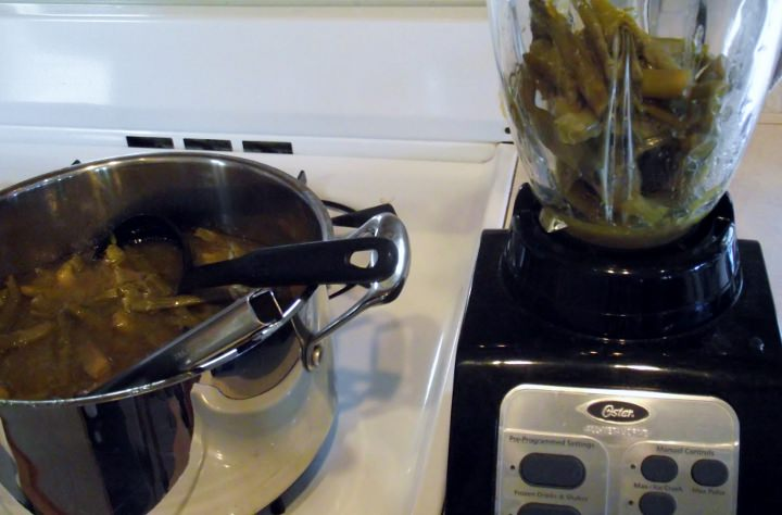 Pureeing the cooked asparagus soup.