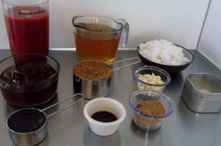 Ingredients for my barbecue sauce recipes: vinegar, spices, onion, garlic, chilies, and quick ketchup.
