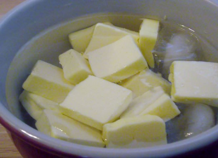 Butter in an ice bath.