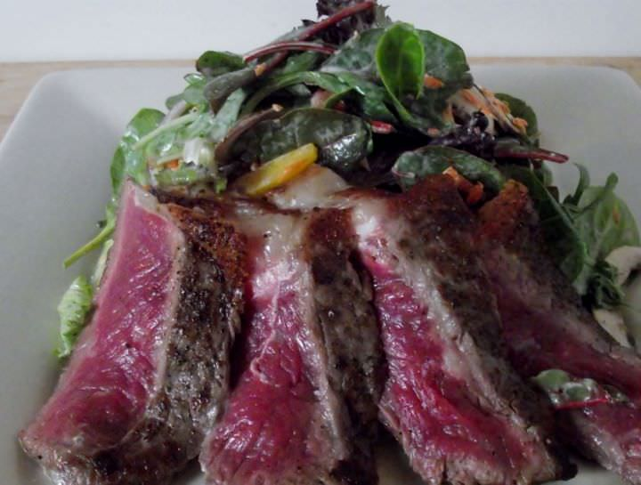 Seared rare NY steak salad.
