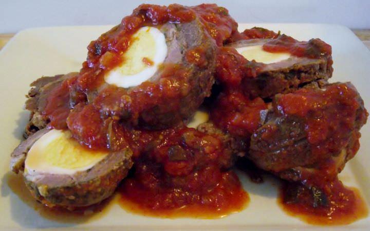 Braciole in sauce on a plate.