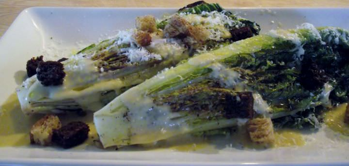 A grilled Caesar salad with croutons and shaved Parmigiano.