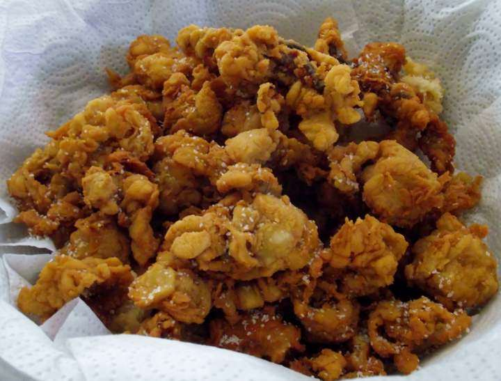 Fried calamari dredged in coconut flour.