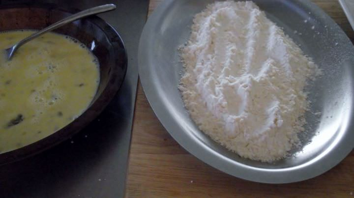Flour and egg inseparate dishes for breading steaks.