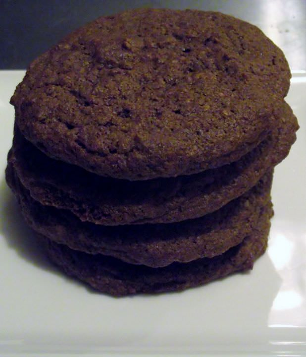Chocolate cookies stacked on a plate.
