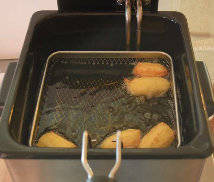 Fry approximately 2-minutes per side. Remove the churros and toss in cinnamon sugar.