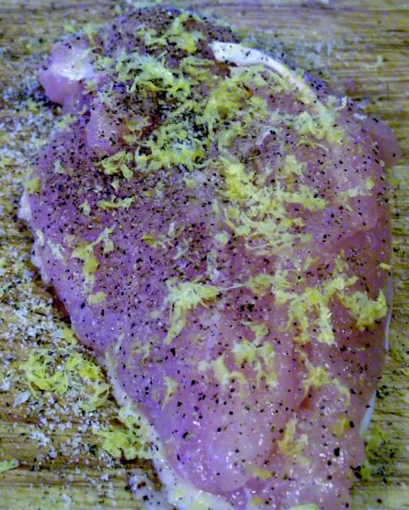 Chicken breast with salt, pepper, and lemon zest.