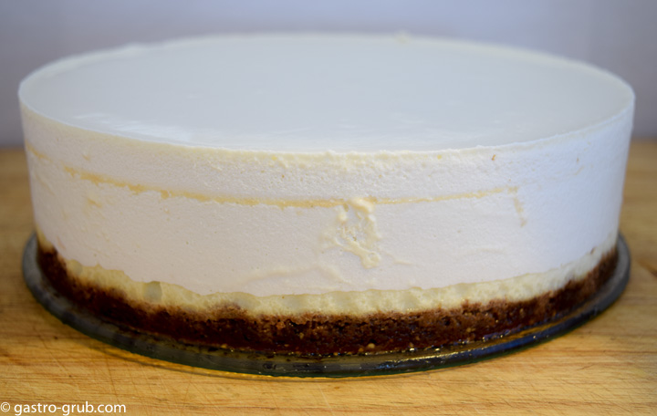 Whole cheesecake on a serving platter.
