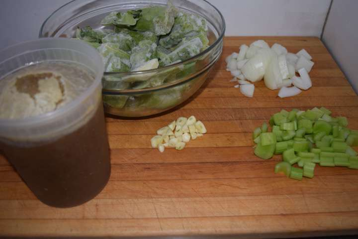 Ingredients to start the soup: broccoli stems, onion, celery, garlic, and stock.