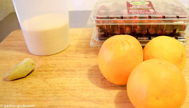 Ingredients for my gourmet cranberry sauce: cranberries, sugar, ginger, and oranges.