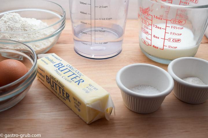 Ingredients for chocolate eclair recipe: eggs, flour, butter, water, milk, salt, and sugar.