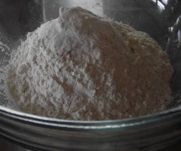 All the dry ingredients for the batter are mixed together in a bowl.