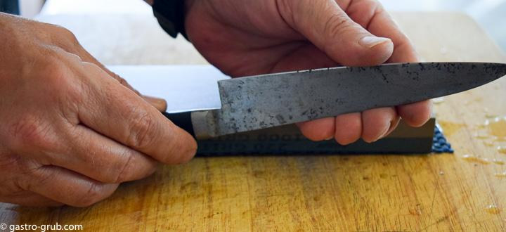 Feeling the blade edge by running my thumb across the edge.