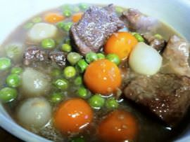 Lamb stew with peas, pearl onions and parisienne carrots.