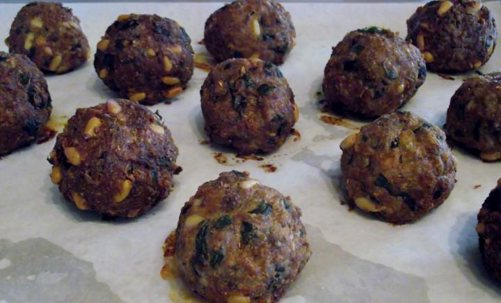 Meatballs on a sheet pan.