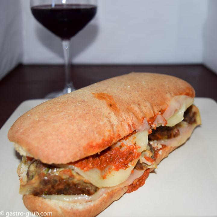 Meatball sub on a plate.