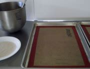 Cookie dough, sugar for coating, sheet-pans and silpats.