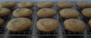 Molasses cookies cooling on a rack.