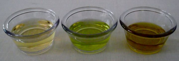 Thre different cooking oils: peanut oil, grape seed oil, and extra virgin olive oil.