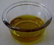 Extra virgin olive oil in a ramekin.