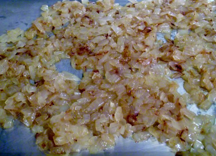 Caramelized onions on a sheet pan.