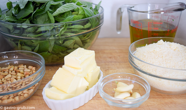Ingredients for pesto: sweet basil, extra virgin olive oil, pine nuts, parmigiano-reggiano and pecorino romano, garlic, and butter.