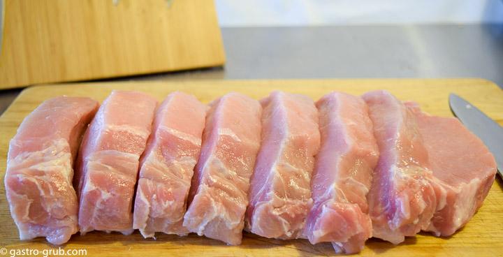 Pork loin sliced into 1-inch pork chops.
