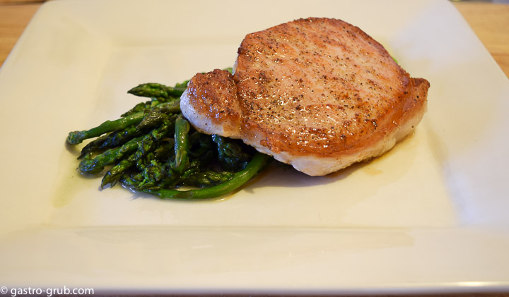 Pork chop and blanched asparagus.