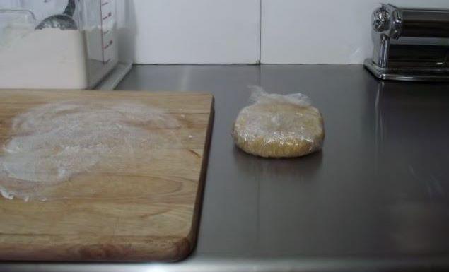 Homemade pasta resting in plastic wrap.