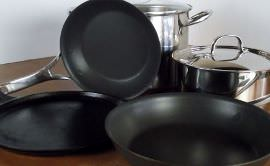 Cast iron griddle, nonstick frying pan and a 3-quart and 12-quart pot.