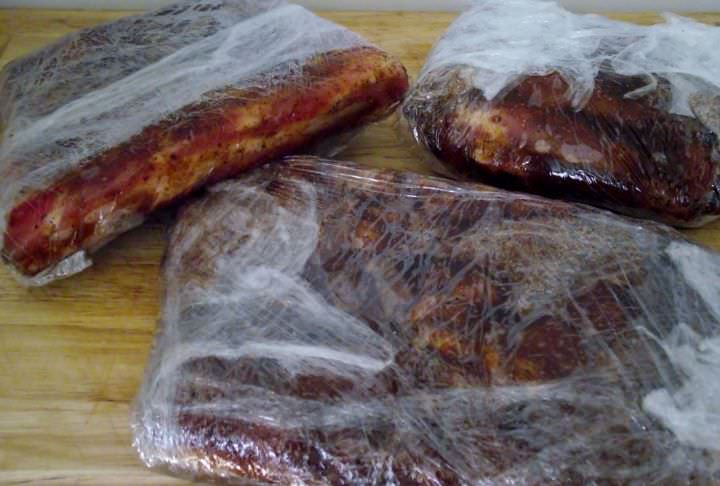 Rib sections coated with dry rub and double wrapped in food grade film.
