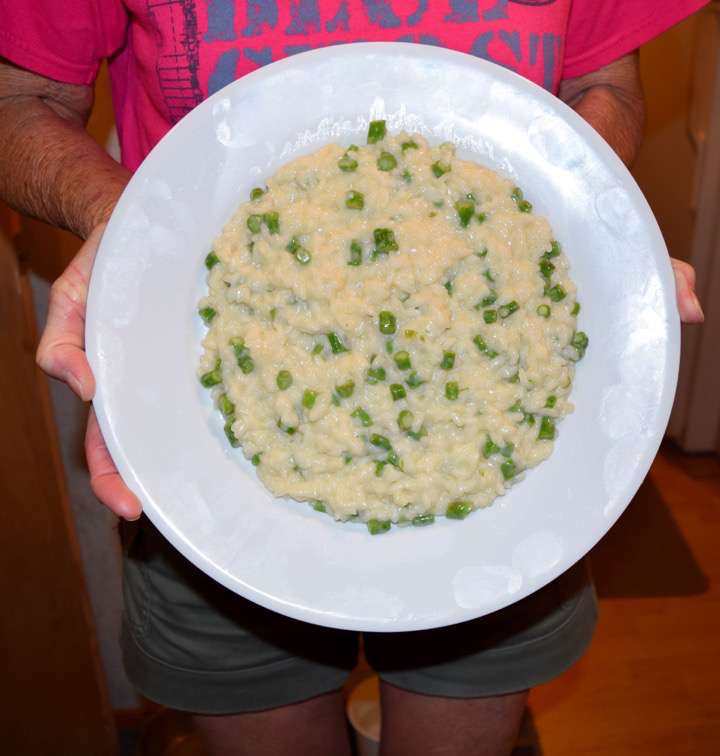 Risotto on a plate, held vertically.