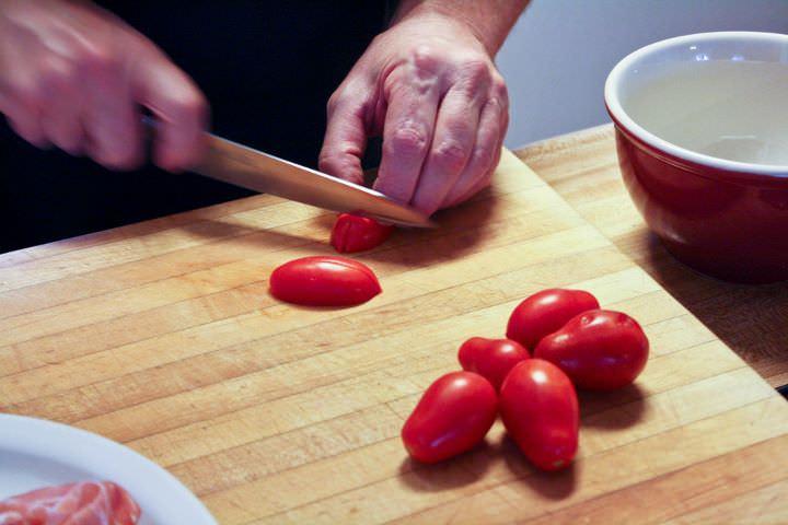 Slicing homegrown roma tomatoes.