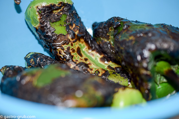 Blackened chilies resting in a bowl.
