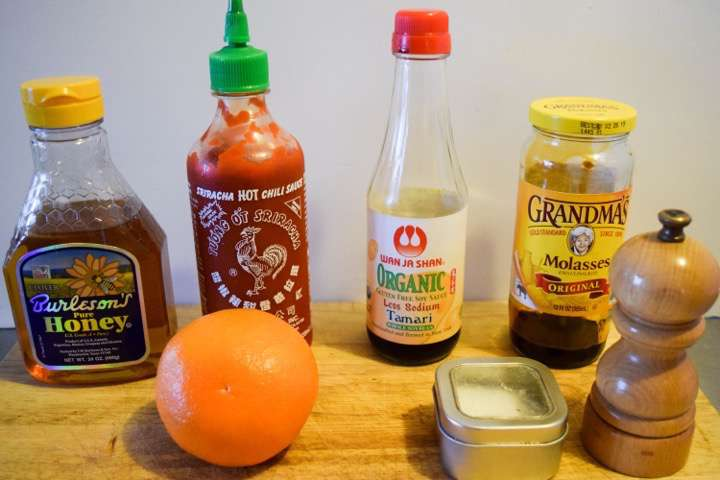 Ingredients for duck glaze: orange juice, honey, tamari, molasses, siracha, salt, and pepper.