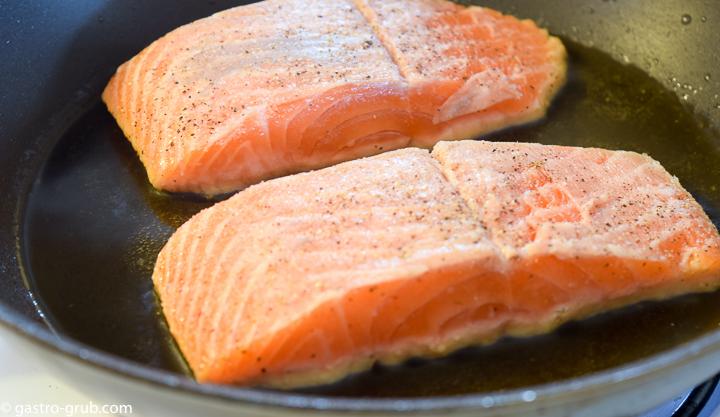 Searing salmon.