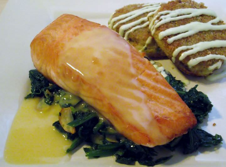 Potato croquettes with green onion aioli and salmon on sauteed greens with beurre blanc.