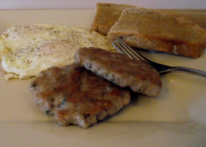 Homemade breakfast sausage, fried eggs, and toast.