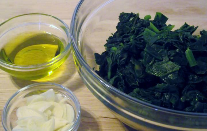 Boiled greens, sliced garlic, and olive oil.