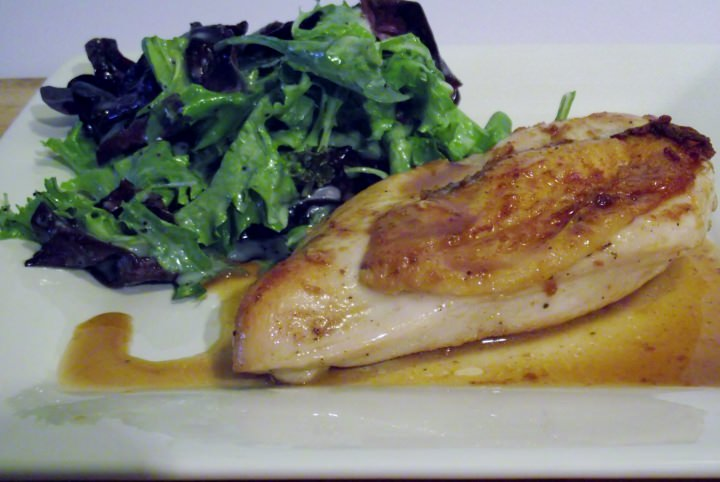 Seared baked chicken, pan sauce and a simple green salad.