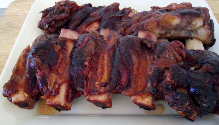 Smoked beef ribs on a plate.