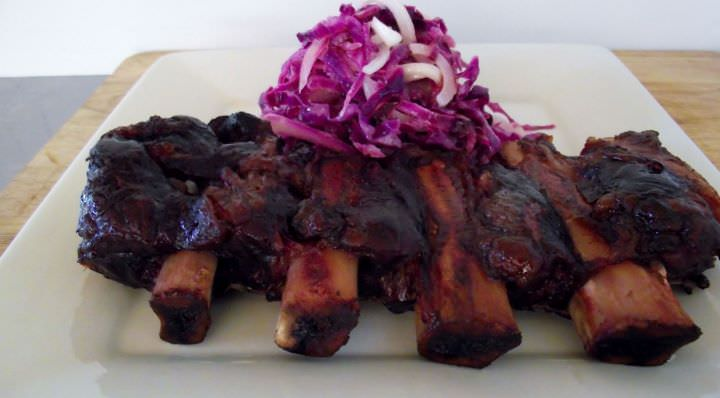 Center cut smoked beef ribs with blanched red cabbage slaw.