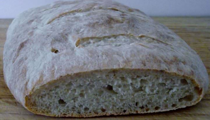 Sourdough bread sliced to show the texture of the crumb.