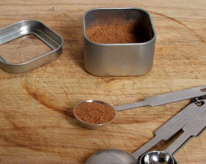 Measuring spoon and spice tin with homemade pumpkin pie spice.