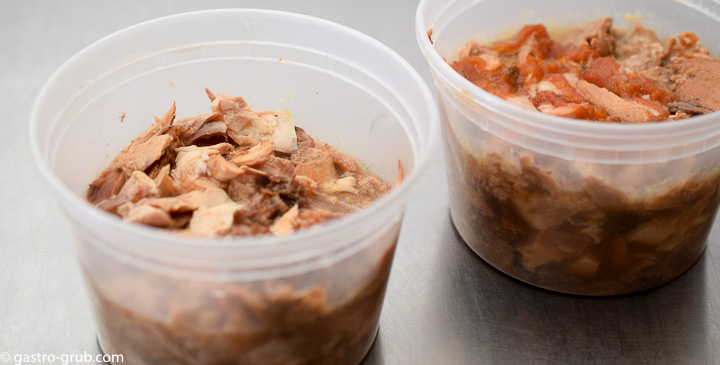 Shredded meat for tacos in pint containers.